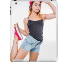 Flexible female teen with red baseball cap wearing black top  iPad Case/Skin