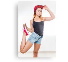 Flexible female teen with red baseball cap wearing black top  Metal Print