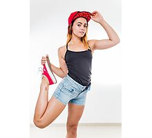 Flexible female teen with red baseball cap wearing black top  Photographic Print