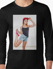 Flexible female teen with red baseball cap wearing black top  Long Sleeve T-Shirt