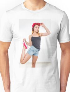 Flexible female teen with red baseball cap wearing black top  Unisex T-Shirt