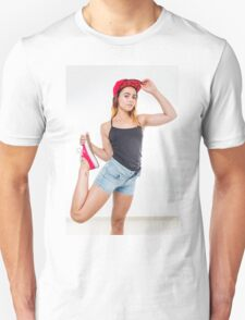 Flexible female teen with red baseball cap wearing black top  T-Shirt