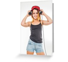 Playful female teen with headphones and red baseball cap wearing black top  Greeting Card