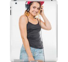 Playful female teen with headphones and red baseball cap wearing black top  iPad Case/Skin