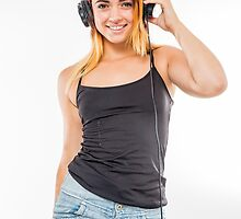 Playful female teen with headphones and red baseball cap wearing black top  by PhotoStock-Isra