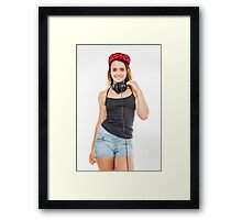 Playful female teen with headphones and red baseball cap wearing black top  Framed Print