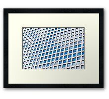 Windows of an office building form a pattern  Framed Print