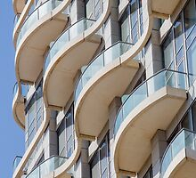 Balconies on a residential building form a repetitive pattern  by PhotoStock-Isra