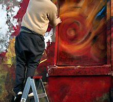 Graffiti artists at work by Rosina  Lamberti