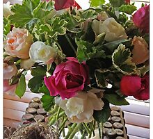 Roses, geranium and birds nest by Barbara Wyeth