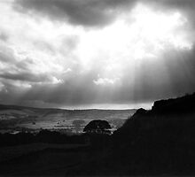 Corbar Cross on a stormy looking evening by stellaozza