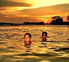 Mekong sunset by John Spies