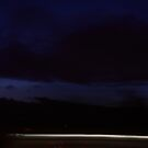 clouded sky - light streak by thesoftdrinkfactory