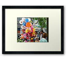 Toys Vendor turns Heads Framed Print