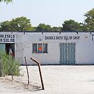 Roadside Shops - Maun, Botswana by Adrian Paul