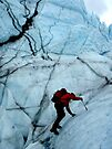 Ice climber hikes ice by LichenRockArts