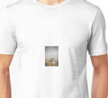 Solitary Tree against the Snowy Hillside Unisex T-Shirt