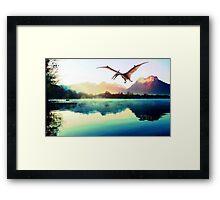Dinosaur next to mountains Framed Print