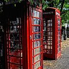 2 Red telephone boxes by Karen  Betts