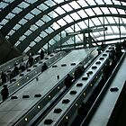 Escalators at Canary Wharf station, London by photoslot