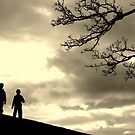 two boys & a tree against the sky by Anima Fotografie