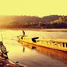Mekong boatman, Luang Prabang, Laos by John Spies