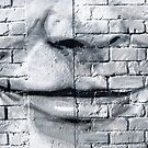 Graffiti smile on the textured brick wall by yurix