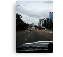 Driving in The City Canvas Print
