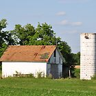 An old barn and silo by mltrue
