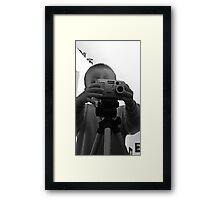a young photographer  Framed Print