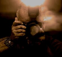 Photographer Capturing Light in Sepia Tones by Buckwhite