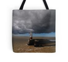 storm over  a lighthouse Tote Bag