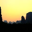 sunset in yangshuo tradtionnal landscape by patrick pichard