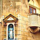 A statue on a street corner in Gozo by DeborahDinah