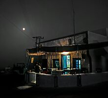 Greek taverna on Santorini with full moon by milton ginos