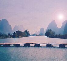 Wooden foot bridge in China by Erika Lafrennie