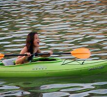 Mara kayaking blur by Diane Philips