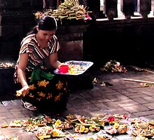 Lady presenting Offerings in the Temple in Ubud Market, Bali  by JonathaninBali