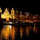 Church of San Lawrenz with Birgu lit up behind. Malta by DeborahDinah