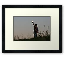 Putting the moon back Framed Print