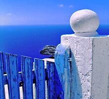 Greek blue gate with wandering clouds by Silvia Ganora