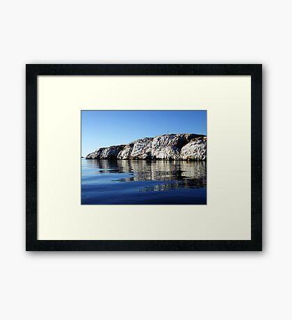A Rock in the Ocean Framed Print