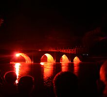 Red firework on bridge in Terrasson for Bastille day by blue-gravity