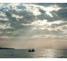 Mirissa Sri Lanka Fishing boats head to the harbour in the morning light by stuwdamdorp