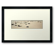 Rocks on sand Framed Print