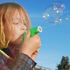 blowing bubbles by Juanita Arnold
