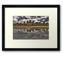 Dark clouds over Angkor Wat Framed Print