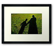 Mommy and child shadow fun  Framed Print