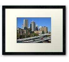 Freeway beside the city Framed Print