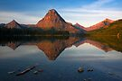 Sinopah Mountain reflected in Two Medicine Lake at Sunrise. Glacier National Park. Montana. USA. by photosecosse /barbara jones
